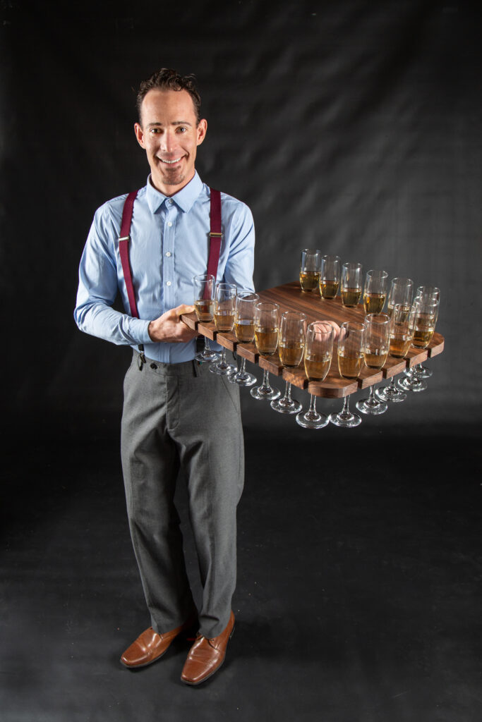 The assistant carries drinks to the dress with this custom tray.